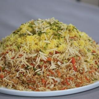 Shirin Polo (plat traditionel Persan de fêtes, garni de zestes d'orange, pistaches, amandes, safran, cannelle)